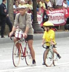 Two cyclist leading a parade at the Tour de France.